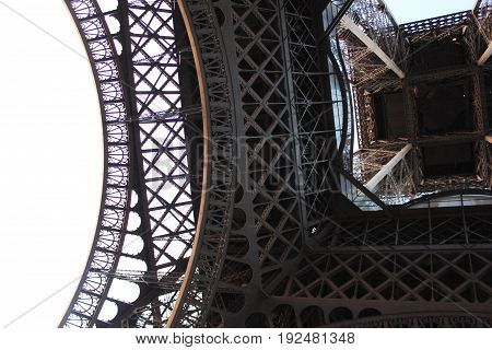 Architecture construction close up detail of Eiffel tower famous symbol of Paris, France. Most visited tourist landmark and city in the world. Travel, vacation concept with empty white background copyspace