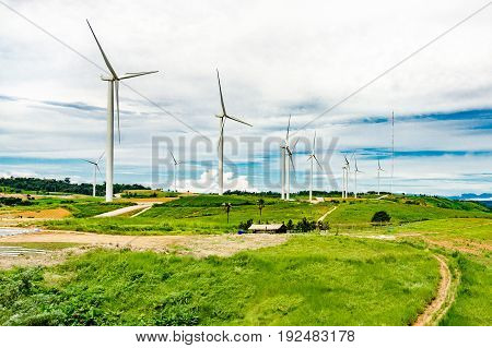 wind turbine and  Meadow A large  located on the mountain.