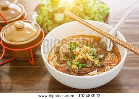 Rice noodles with spicy pork sauce (Nam ngiao) Nam ngiao has a characteristic spicy and tangy flavor. Thai food.