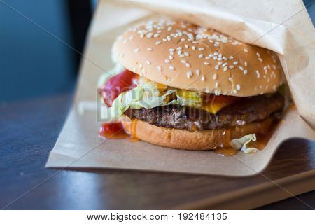 juicy hamburger with beef and ketchup on the table. beef burger for lunch.