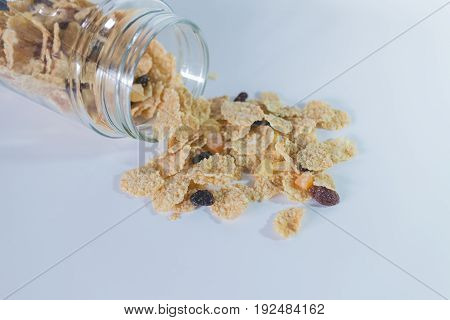 whole grain cereal flakes with raisins. Cereal cornflakes on white background.