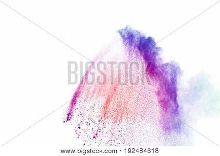 abstract multicolored powder splatted on white backgroundFreeze motion of color powder exploding