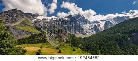 Panoramic Summer view of the mountains and glaciers in Ecrins National Park (Bec de L'Homme La Meije Glacier du Tabuchet) from the village of La Grave. Hautes-Alpes PACA Region Southern French Alps France