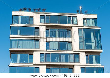 Modern apartment house with a lot of glass seen in Berlin, Germany