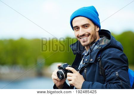 Young modern blogger with photocamera