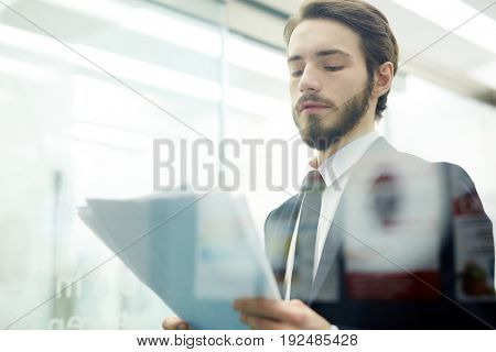 Businessman with papers making report