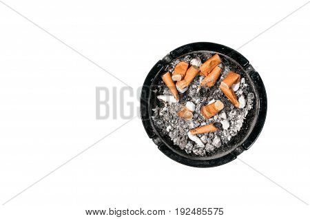 Ashtray. Dirty ceramic black ashtray, full of cigarette butts. Isolated on a white background. View from above.