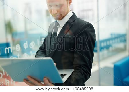 Serious man working with online data
