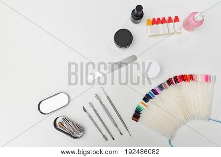 Set For Manicure. Tools, Nail File, Palette, Care Products. White Background. Space For Text