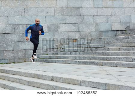 Young runner training in urban environment