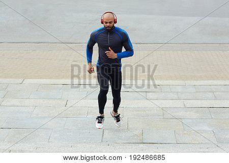 Young man jogging in urban environment
