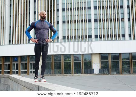 Young athlete in sportswear in urban environment