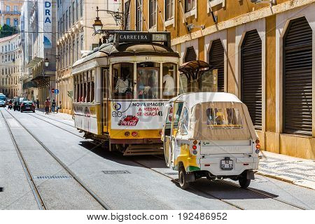 Lisbon, Portugal - May 18, 2017: The Famous Old Tram No. 28 And Tuk Tuk In Lisbon