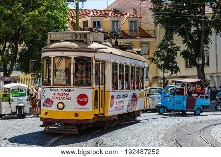 Lisbon, Portugal - May 19, 2017: The Famous Old Tram No. 28 And Tuk Tuk In Lisbon