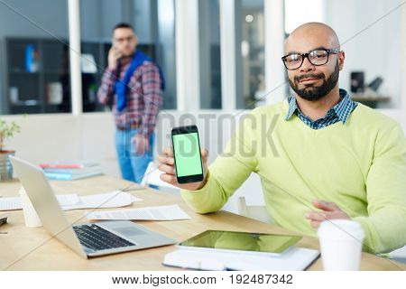 Creative man sharing information in his smartphone