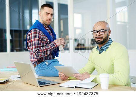 Modern designers working in office