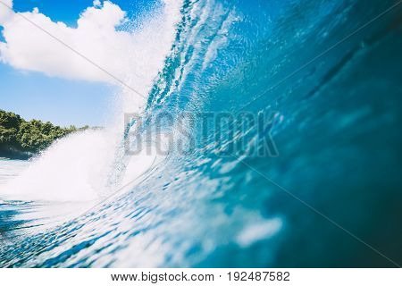 Blue wave in ocean. Clear wave and blue sky