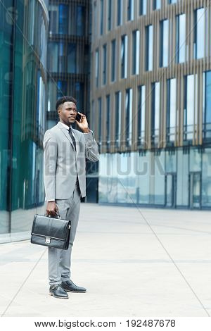 Modern trader calling one of business partners