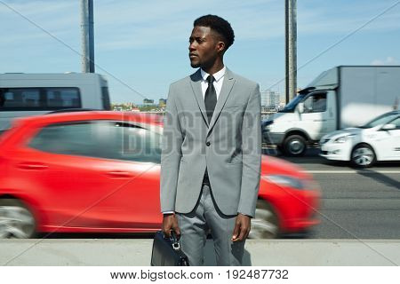 Young agent standing by highway