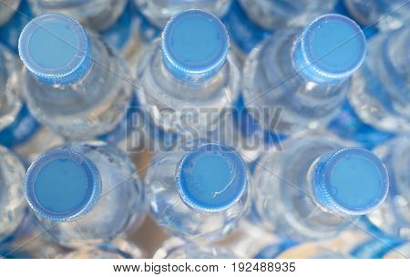 Rows of water bottles on the table