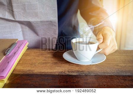 Coffee Cup Clock And Work On Table