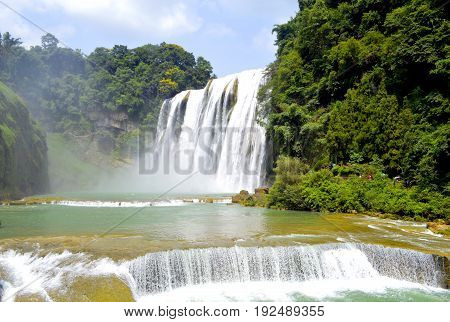 China Guizhou Anshun Huangguoshu Waterfall in Summer. One of the largest waterfalls in China and East Asia classified as a AAAAA scenic area by the China National Tourism Administration.