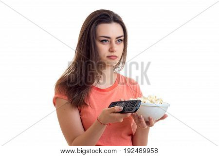 Woman with remote and pop corn watching a tv isolated on white background