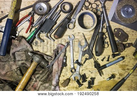 DIY working tools on wooden rustic background. top view