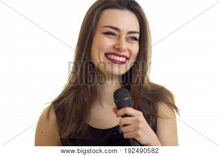 Cheerful woman with beautiful make up smiling with microphone in hands isolated on white background