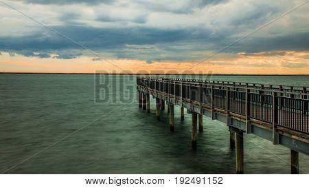 A small pier under a threatening sky