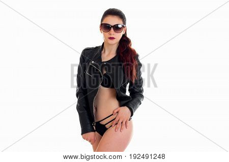 Glamour woman in sunglasses and leather jacket isolated on white background