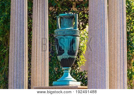 Atlanta, Georgia, USA - December 22, 2016: The sculpture of funeral urn and columns closeup on the Oakland Cemetery in sunny autumn day