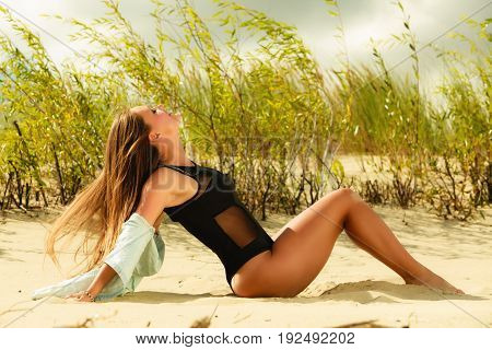 Young Woman Posing In Grassy Dune