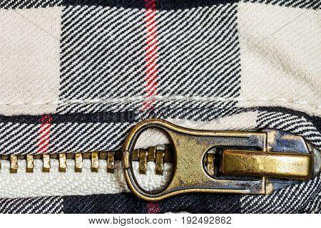 Zipper a detail of jeans close up