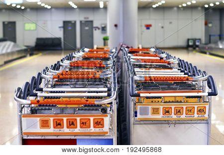 Beijing, China, June, 2017. Baggage Trolley Line Up at Beijing Capital Airport (PEK) Terminal 2 June 14 2017.