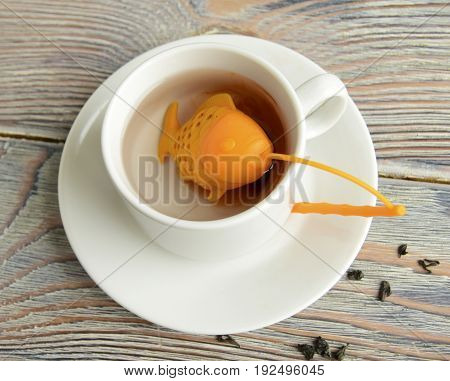 Strainer for tea. The strainer is made in the form of fish. In a strainer there is a tea. The strainer is made of silicone.