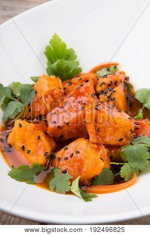 Indian food dish with sesame seeds and parsley