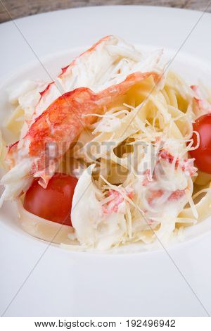 Seafood pasta dish with crab and parmesan cheese