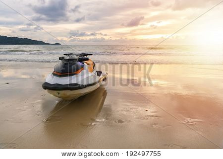 Jet ski parking on the Beach with ray of light