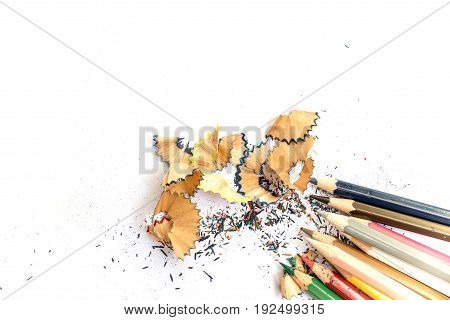 Wooden Colorful Pencils With Sharpening Shavings, On White Paper
