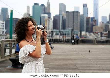 Young beautiful woman photographing in new York