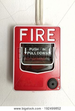 fire alarm switch on cement wall for warning and security system