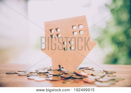 Wood House Model With Coin, Savings Plans For Housing ,financial Concept, Warm Tone