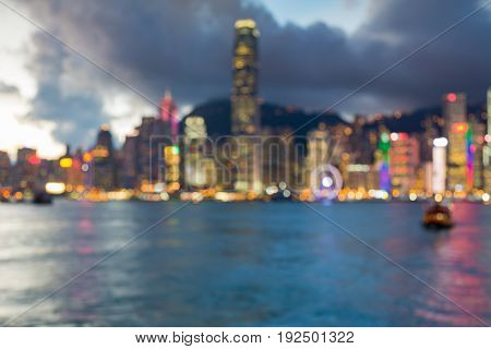 Twilight blurred bokeh light Hong Kong downtown sea front abstract background