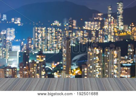 Opening wooden floor Apartment on high hill blurred bokeh light abstract background Hong Kong cityscape night view