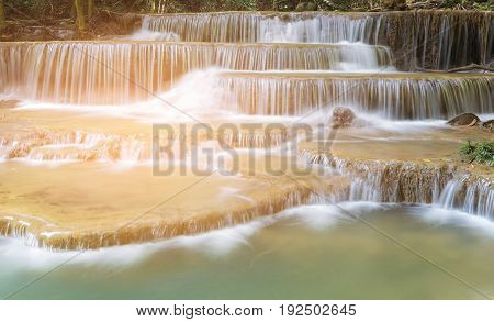 Multiple layers waterfall in tropical deep forest