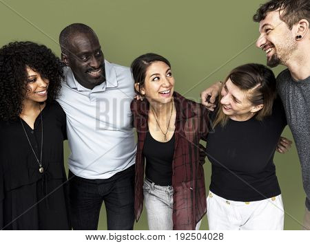 Group of people smiling and huddle together