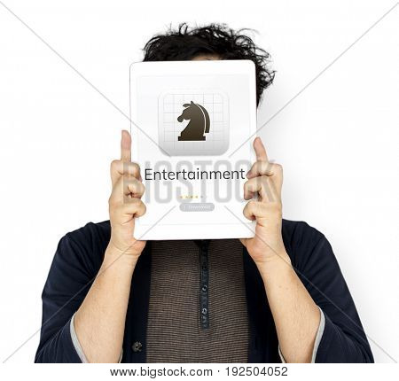 Man holding tablet cover his face about download chess game