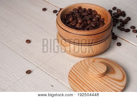 A Wooden Bowl With Coffee Beans On Old Wooden Table,