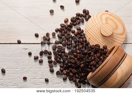 Coffee Beans Scattered From A Cup On White Wooden Background, Wooden Utensils,